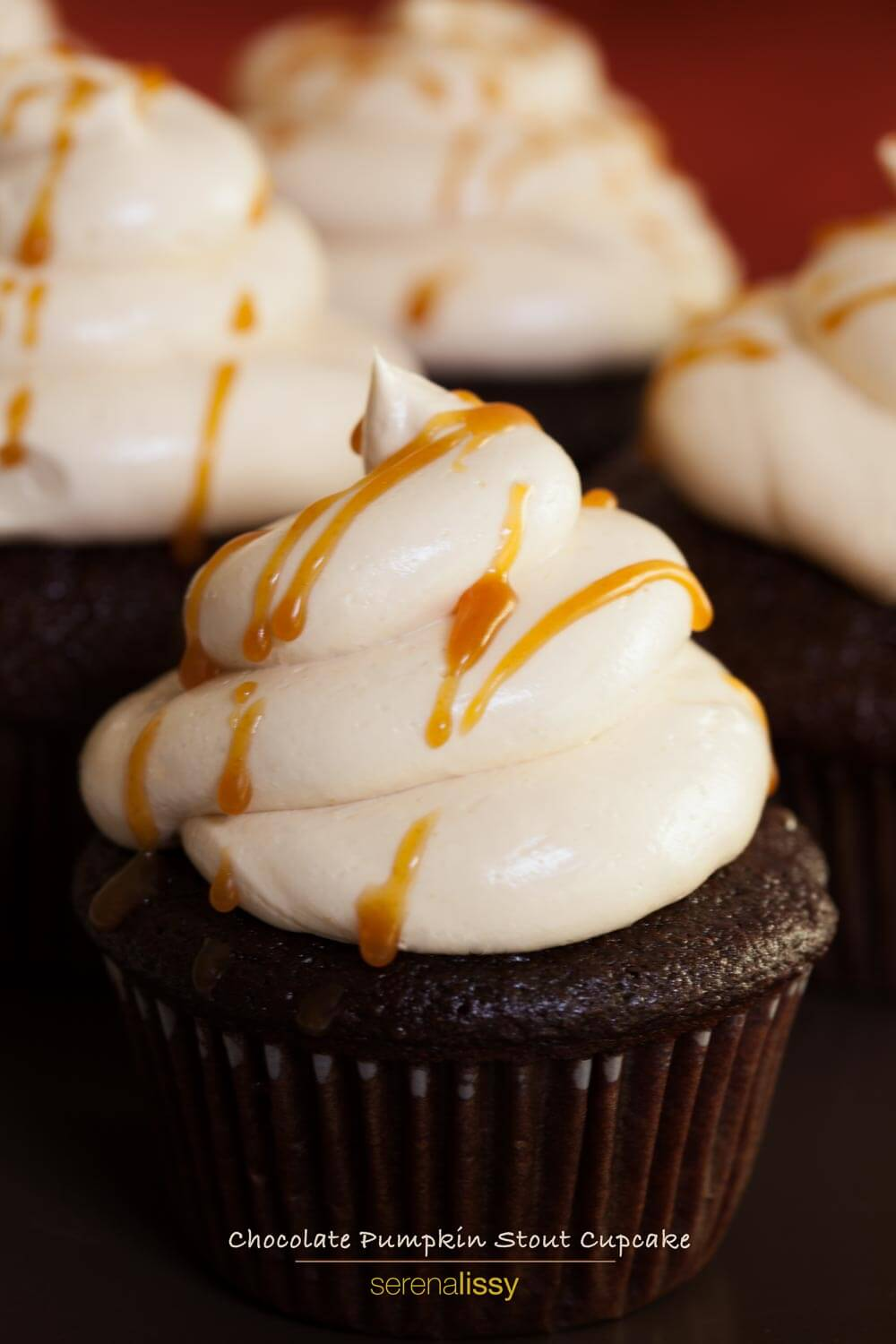 Chocolate stout cupcakes topped with salted caramel frosting and a drizzle of caramel.