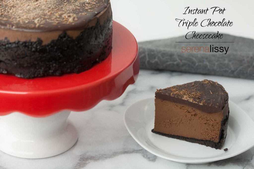 Piece of Instant Pot Triple Chocolate Cheesecake on a plate next to whole instant pot cheesecake