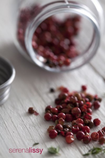 Peppercorns on cutting board
