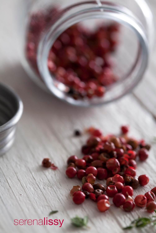 Peppercorns on cutting board