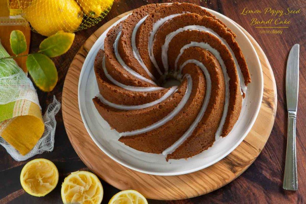 Lemon Poppy Seed Bundt Cake On Plate with lemons