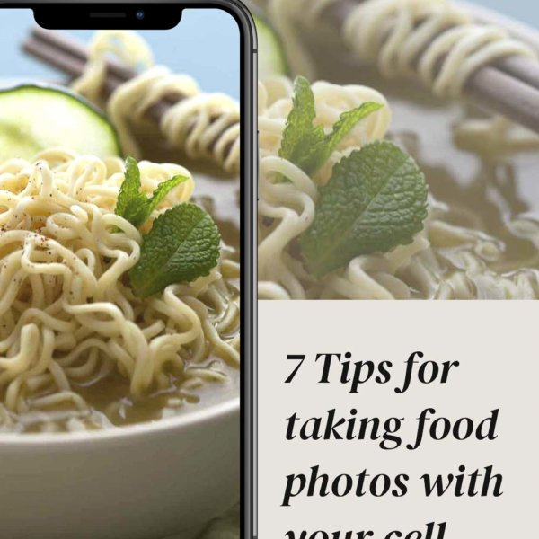 cell phone taking picture of bowl of noodles