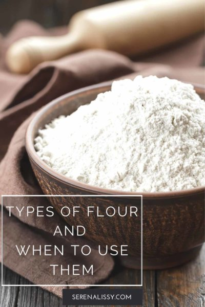 Bowl of flour on table with rolling pin