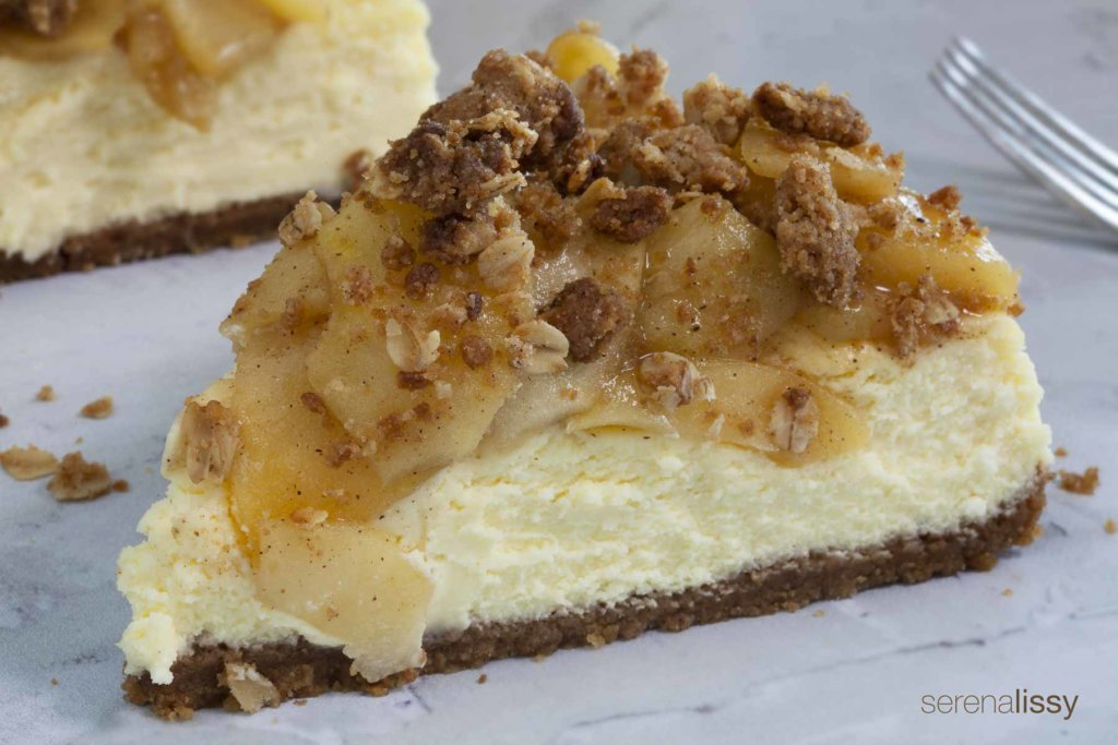 Slice of Apple Crumble Cheesecake on Table